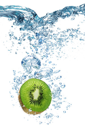 water drip: Bubbles forming in blue water after kiwi is dropped into it. Stock Photo