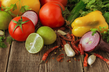 tomatos: Fresh and juicy vegetables on wooden table