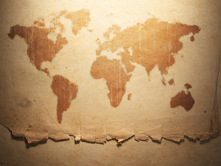 old letters: world map displayed on the corrugated old paper. Close up