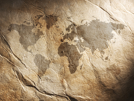 displayed: world map displayed on the corrugated old paper. Close up