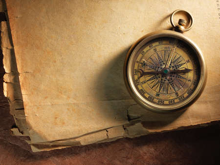 Vintage compass on the very old paper Stock Photo