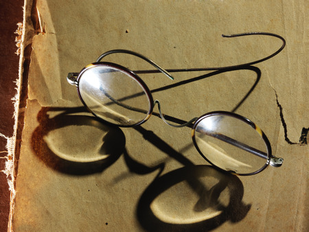 Vintage glasses on the very old paper photo