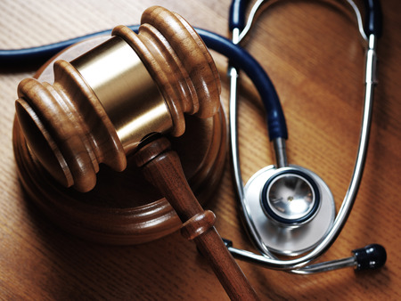 judge: Judge gavel and stetaskop on wooden background. Close up