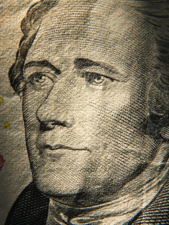depicted: Alexander Hamiltons portrait is depicted on painted on the $ 10 banknotes. Close up