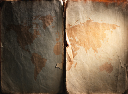 displayed: world map displayed on the spread of vintage books. Close up