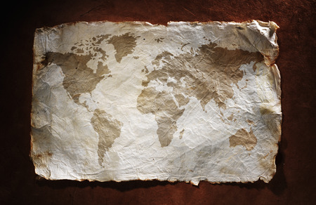 old world map: world map displayed on the corrugated old paper. Close up