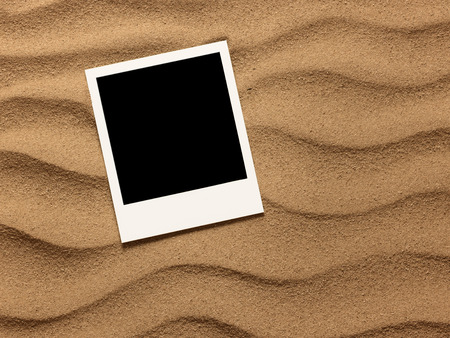 sand background: Photo frame on sand background. Close up