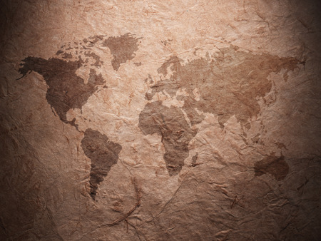 paper old: world map displayed on the corrugated old paper. Close up