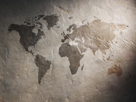 word art: world map displayed on the corrugated old paper. Close up