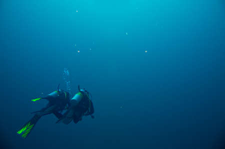 Couple of scuba divers set out on an underwater adventure in Red Sea