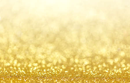 yellow star: Gold Festive Christmas background. Abstract twinkled bright background with bokeh defocused golden lights