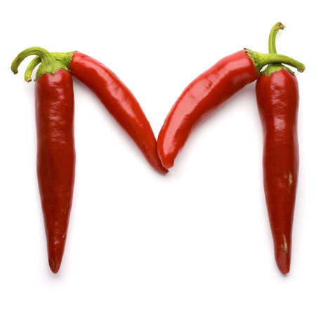 out of order: Close up view of the letter M made of pepper