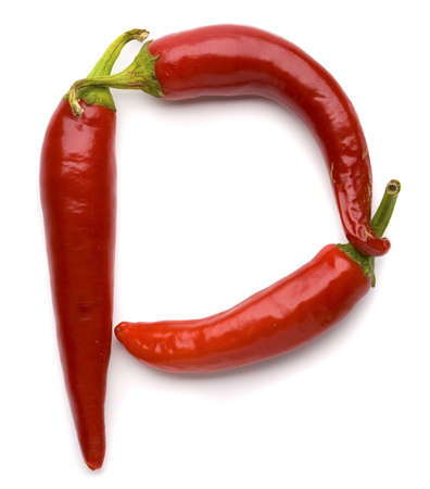 close p: Close up view of the letter P made of pepper
