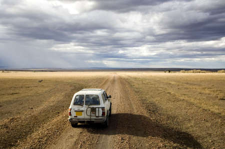 view of a 4X4 in the middle of a plain in the natural reserve of masai mara.