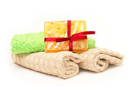 Soap and three towels photo