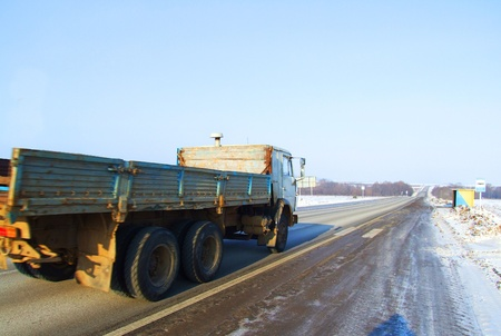 Truck driving on winter roads photo