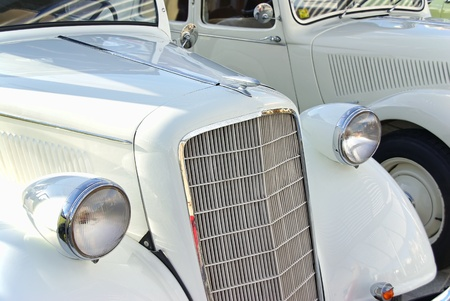 Details of two Classical white cars photo