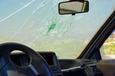 cracked glass: Damaged car window after a crash