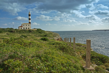 colom: Porto Colom Lighthouse in the east side of the island of Mallorca (Spain) Stock Photo