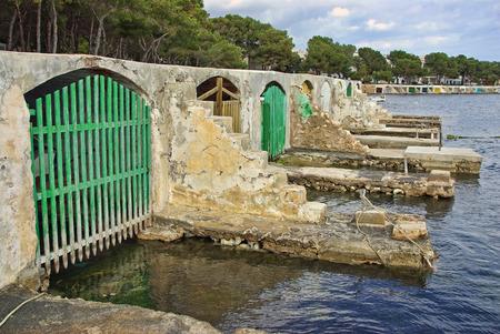 colom: Typical fishermen boat shelters in Porto Colom (Felanitx - Majorca - Balearic Islands - SPAIN) Stock Photo