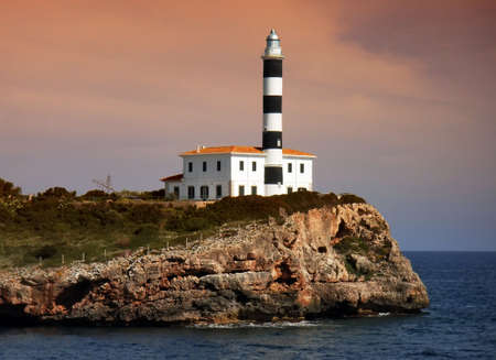 colom: Port Colom lighthouse at dawn (Balearic Islands - Spain) Stock Photo