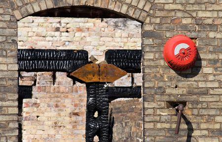 burned out: External sprinkler alarm on a burned out century old factory