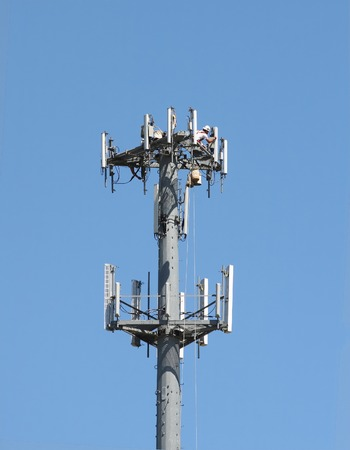 Maintenance on the antenna of a cellular phone tower photo