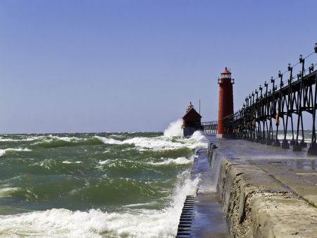 very windy: A very windy day on Lake Michigan at the Grand Haven Lighthouse and Pier Stock Photo