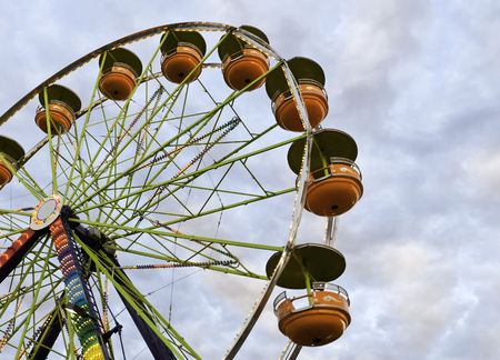 carny: A Ferris Wheel at a county fair against a colorful evening sky.