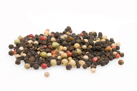 piperine: Whole Peppercorns isolated on a white background Stock Photo