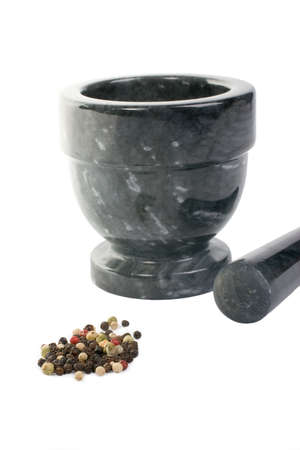 piperine: Whole Peppercorns with a Mortar and Pestle