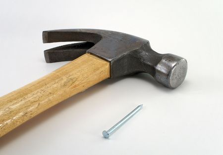 pounding head: Hammer and Nail Stock Photo