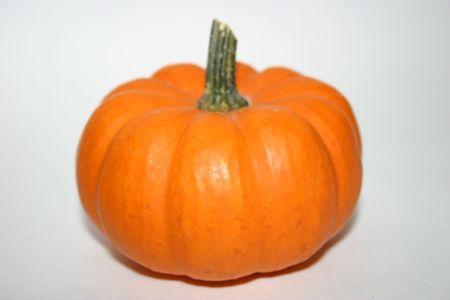 Pumpkin sitting by itself. photo
