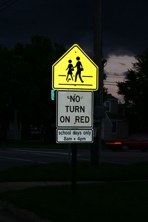 Walk and no turn on red signs illuminated at night. Stock Photo - 2093643