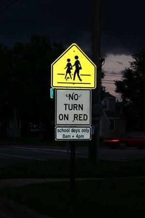 Walk and no turn on red signs illuminated at night. Stock Photo - 2093643