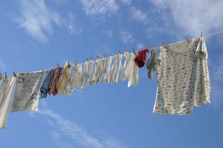 A laundry line in a crisp blue sky. Stock Photo - 2093637