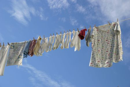 hanged woman: A laundry line in a crisp blue sky. Stock Photo