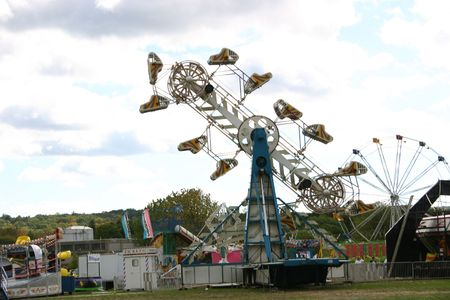 carny: A carnival with rides.
