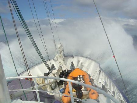 BOAT SPLASHING INTO WAVE