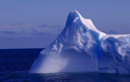 AN ANTARCTICA ICEBERG ADRIFT IN SOUTHERN SEAS