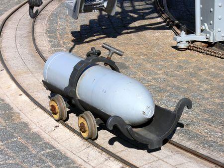 gun shell: very big gun shell in its transport cart