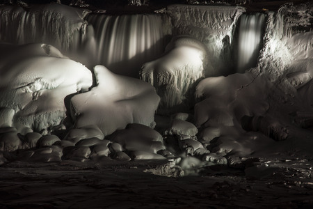 The American Falls lit up at night in the winter time, Niagara Falls, NY. Stock Photo