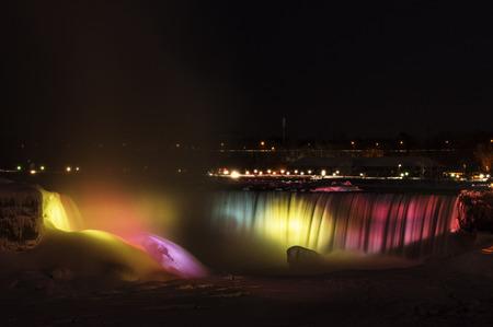 The Horseshoe Falls lit up at night in Niagara Falls, Ontario, Canada.