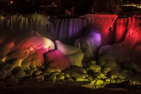 The lights illuminate the ice and water on the American Falls, Niagara Falls, NY.