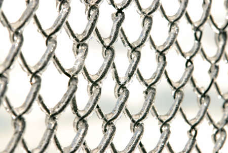 Photo of a chain link fence after an ice storm. Stock Photo