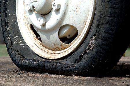 flat tyre: Old worn flat tyre