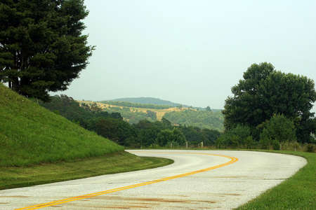 rural skyline: A curvy road with a beautiful view.