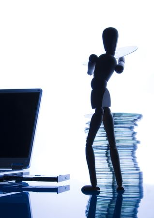 businessmans attribute: Laptop with figure over white background.
