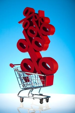 Shopping cart with sign of percentage, sale Stock Photo - 18377728