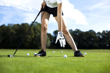 Girl playing golf  photo